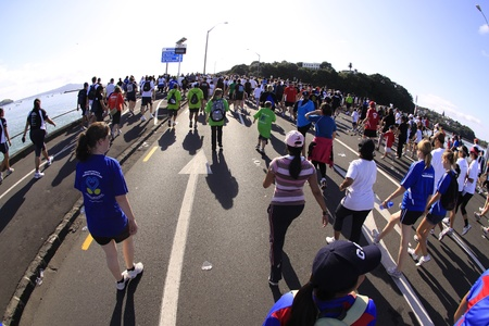entrants: AUCKLAND- Mar. 13: Participants of Auckland Round the Bays, one of the worlds largest fun walk and run with an estimated 70,000 entrants, in Auckland, New Zealand on Sunday March 13, 2011.