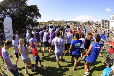 entrants: AUCKLAND- Mar. 13: Participants walking to the finish line of Auckland Round the Bays, one of the worlds largest fun walk and run with an estimated 70,000 entrants, in Auckland, New Zealand on Sunday March 13, 2011.