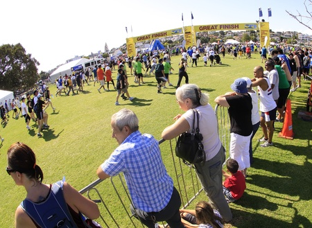 AUCKLAND- Mar. 13: Spectators and participants of Auckland Round the Bays, one of the worlds largest fun walk and run with an estimated 70,000 entrants, in Auckland, New Zealand on Sunday March 13, 2011, nearing the finish line Editorial