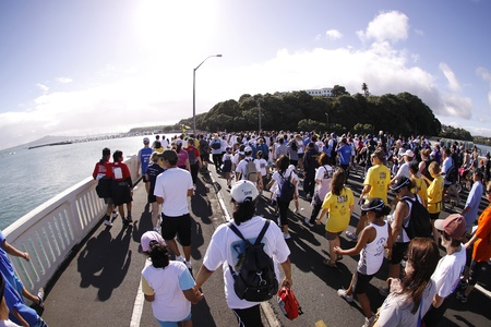 AUCKLAND- MARCH 14: Participants of Auckland Round the Bays,one of the worlds largest fun-runs with an estimated 70,000 entrants, in Auckland, New Zealand on March 14, 2010.