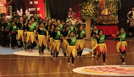 northshore: AUCKLAND - Jan 16: Filipino Catholic devotees dance and perform in the Annual Feast of the Child jesus or Sinulog Santo Nino at the Northshore Event Center in Auckland, New Zealand on January 16, 2011.