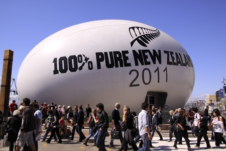 Tourists and locals gather around to view the giant rugby world cup ball at the Auckland Viaduct in Auckland, New Zealand on Friday September 23, 2011.