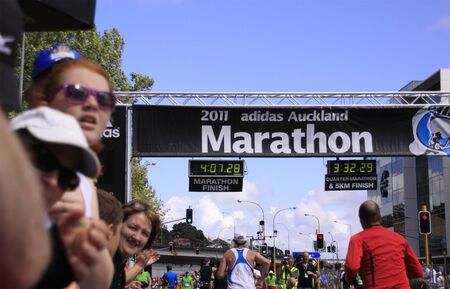 adidas: Participants in the Adidas Auckland marathon run sprint to the finish line on Sunday Oct. 30,2011 at  Auckland, New Zealand
