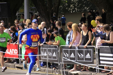 participant: Participant in Auckland marathon dress as superhero run sprint to the finish line on Sunday Oct. 30,2011 at  Auckland, New Zealand