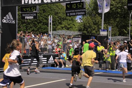 Participants in the Adidas Auckland Kids marathon run sprint to the finish line on Sunday Oct. 30,2011 at  Auckland, New Zealand