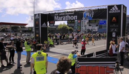 Participants in the Adidas Auckland marathon run sprint to the finish line on Sunday Oct. 30,2011 at  Auckland, New Zealand
