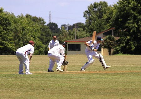 an umpire:  Cricket player batsman batting with wicket and wicket keeper on Saturday Jan. 15,2011 at  Pakuranga Cricket Club in Auckland, New Zealand Editorial