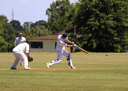 wicket:  Cricket player batsman batting ball with wicket and wicket keeper on Saturday Jan. 15,2011 at  Pakuranga Cricket Club in Auckland, New Zealand