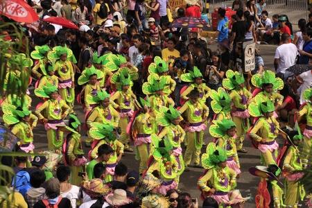 CEBU CITY - Jan 15: Filipino Catholic devotees dance and perform in the Annual Feast of the Child jesus or Sinulog Santo Nino Parade  in Cebu City, Philippines on Sunday, January 15, 2012. Stock Photo - 12060614