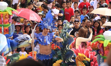 CEBU CITY - Jan 15: Filipino Catholic devotees dance and perform in the Annual Feast of the Child jesus or Sinulog Santo Nino Parade  in Cebu City, Philippines on Sunday, January 15, 2012.