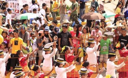 CEBU CITY - Jan 15: Filipino Catholic devotees dance and perform in the Annual Feast of the Child jesus or Sinulog Santo Nino Parade  in Cebu City, Philippines on Sunday, January 15, 2012.