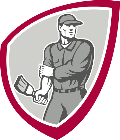 rolling up: Illustration of a house painter with paintbrush rolling up sleeves facing front set inside shield crest done in retro style on isolated background.