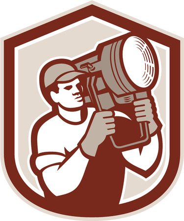 lighting technician: Illustration of a electrical lighting technician crew carry fresnel spotlight on shoulder looking to side set inside shield crest shape on isolated background done in retro style.