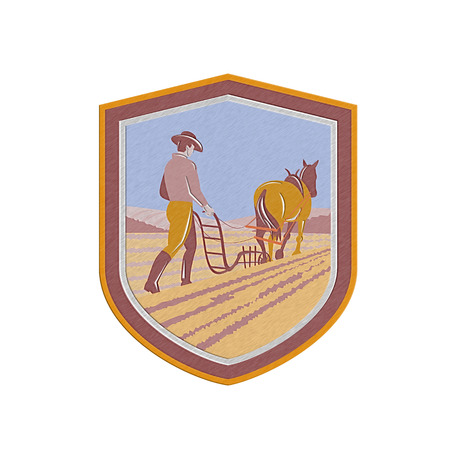 plough: Metallic styled illustration of farmer and horse plowing farm field viewed from back set inside crest shield done in retro style on isolated background.  Stock Photo