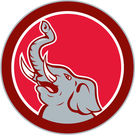 elephant angry: Illustration of an angry elephant head roaring with tusk and trunk up facing side on isolated background set inside circle done in cartoon style.