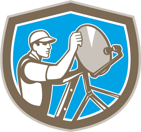Illustration of a TV satellite dish installer set inside shield crest on isolated background done in retro style.  Vector