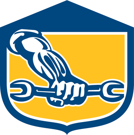 hand wrench: Illustration of a mechanic hand holding spanner wrench set inside shield crest on isolated background done in retro style.