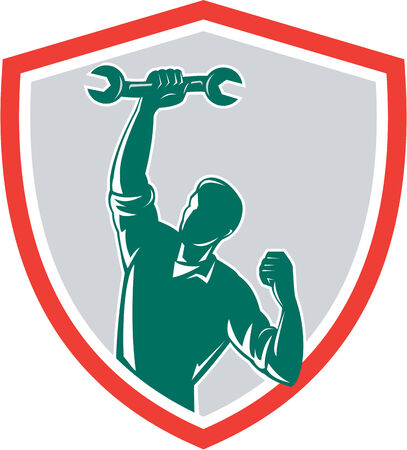 Illustration of a mechanic holding spanner wrench pumping fist set inside shield crest on isolated background done in retro style.