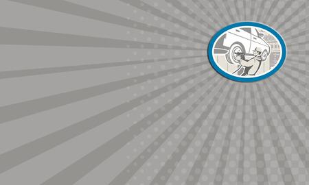 mecanico automotriz: Tarjeta de negocios que muestra la ilustraci�n de un mec�nico automotriz cambia la reparaci�n de autom�viles neum�tico de un veh�culo autom�vil en el garaje taller conjunto dentro de �valo hecho en estilo retro. Foto de archivo
