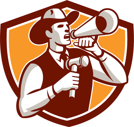 announcing: Illustration of a cowboy auctioneer holding bullhorn and gavel shouting announcing viewed from the side on isolated background set inside shield crest done in retro style.