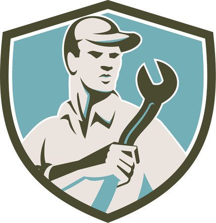 front facing: Illustration of a mechanic wearing hat holding spanner wrench facing front inside shield crest on isolated background done in retro style.