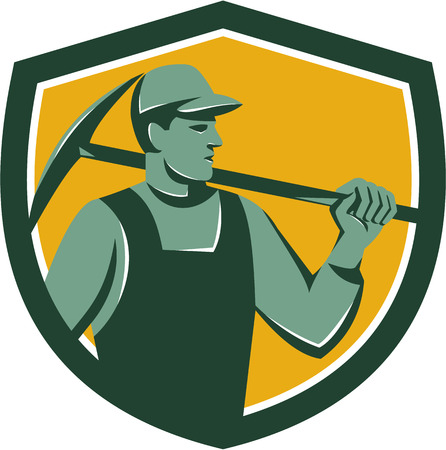 pick axe: Illustration of a coal miner wearing hat holding crossed pick axe on shoulder looking to the side set inside shield on isolated background done in retro style.