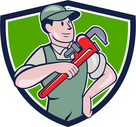 monkey wrench: Illustration of a plumber in overalls and hat pointing monkey wrench looking to the side set inside shield crest on isolated background done in cartoon style.