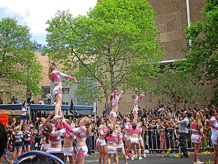 girls youth: AUCKLAND- OCT. 24: Cheerleaders performing a stunt or routine during the RWC 2011 Champions parade on Oct. 24, 2011 in Auckland, New Zealand.