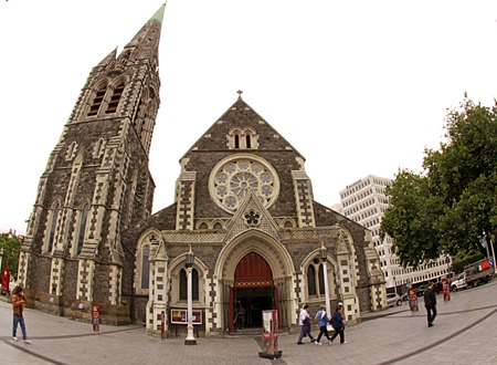 christchurch: CHRISTCURCH-Dec. 7: Tourist and pedestrians walk by Christchurch Cathedral, an Anglican church in the Cathedral Square taken on Dec. 7, 2010 in Christchurch, New Zealand. Editorial