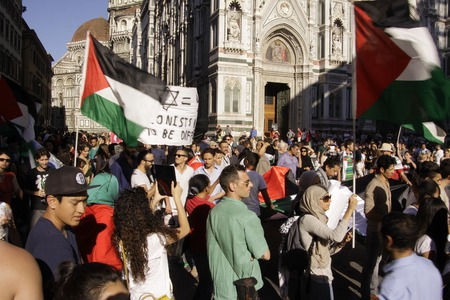 demonstrators: FLORENCE- JUL. 17: Anti-Israeli and Pro-Palestenian demonstrators waving Palestine flags turn up to call for an end to military strikes on Gaza at Piazza del Duomo in Florence, Italy on July 17, 2014.