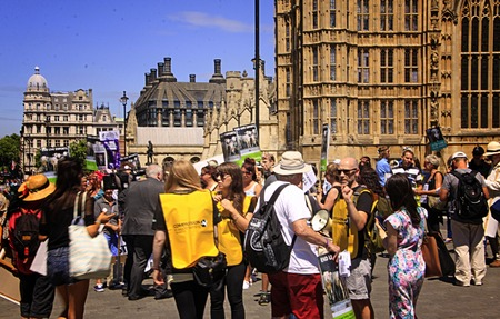 protestors: LONDON- JUL. 4: British protestors and activist with placards and signs protesting to end or stop live animal exports from UK, Great Britain in London, England on July 4, 2014.