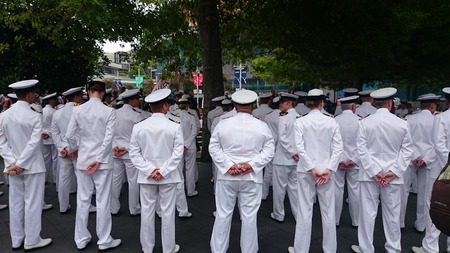 ready for war: AUCKLAND-DEC.13: New Zealand Navy Naval officers and enlisted personnel get ready for the parade to commemorate the 75th anniversary of the Battle of the River Plate in the South Atlantic during World War 2 on Dec. 13, 2014 in Auckland. Editorial