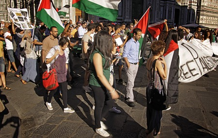 gaza: FLORENCE- JUL. 17: Anti-Israeli and Pro-Palestenian demonstrators waving Palestine flags turn up to call for an end to military strikes on Gaza at Piazza del Duomo in Florence, Italy on July 17, 2014.