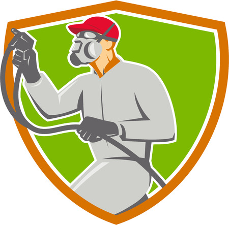 paint spray gun: Illustration of car painter wearing face mask holding paint spray gun spraying viewed from the side set inside shield crest done in retro style.