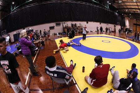 scholastic: AUCKLAND-JUL. 3, 2015: Wrestlers, 16-20 years old from USA, Australia, New Zealand and American Samoa participate and compete in the International Downunder Wrestling Challenge at the North Shore Event Centre, Auckland New Zealand.