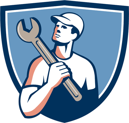 Illustration of a tradesman mechanic wearing hat holding spanner on shoulder looking up to the side set inside shield crest on isolated background done in retro style.
