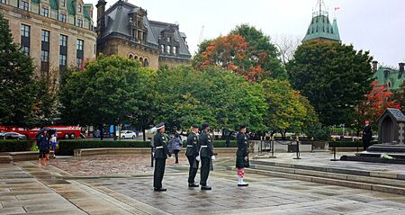 ceremonial: OTTAWA, SEP. 30: Ceremonial guards march by the Tomb of the Unknown Soldier at the National War Memorial in Ottawa, Canada on Sep. 30, 2015. Editorial