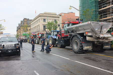 protester: OTTAWA- SEP. 29: Canadian dairy farmers from eastern Ontario drove their tractors to Parliament Hill to protest possible dairy concessions in the soon-to-be-signed Trans-Pacific Partnership in Ottawa on Sep. 29, 2015.