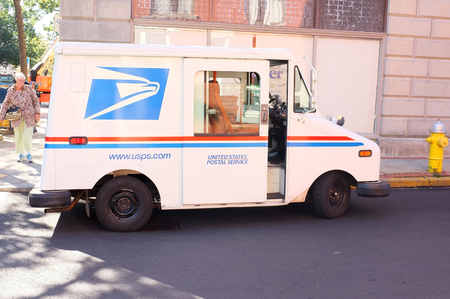 united states postal service: SEATTLE, OCT. 8: United States Postal Service USPS Delivery van truck parked in downtown Seattle, Washington, United States taken on Oct. 8, 2015. Editorial