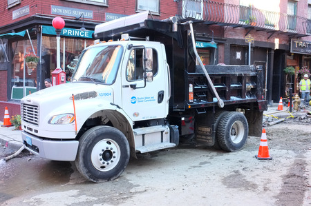 axle: BOSTON, OCT.7: Single axle truck chassis equipped with dump body parked at a roadworks construction site in Boston, Massachusetts, United States taken on Oct. 7, 2015.