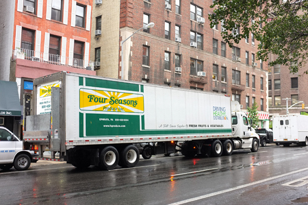cartage: NEW YORK, SEP. 30: Four Seasons truck and Trailer delivery truck parked in downtown New York City, New York, United States taken on Sep. 30, 2015.