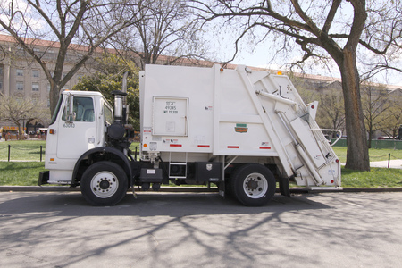 lorry: WASHINGTON D.C., OCT. 4: Garbage rubbish truck with rear end loader parked in Washington D.C., United States taken on Oct. 4, 2009.