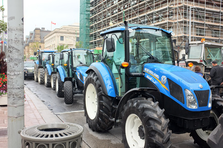 canada agriculture: OTTAWA, SEP. 30: New Holland Tractors Ottawa  parked in Parliament Hill, Ottawa, Ontario, Canada taken on Sep. 30, 2015. Editorial