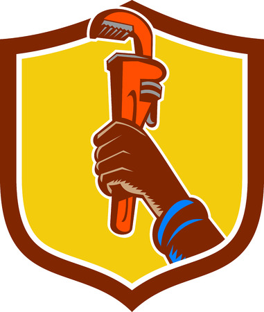 hand raising: Illustration of a black plumber hand raising monkey adjustable wrench viewed from the side set inside shield crest done in retro style.