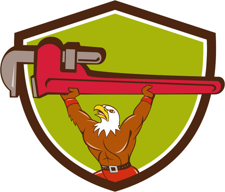 adjustable wrench: Illustration of a american bald eagle plumber lifting giant monkey adjustable wrench over head looking up to the side set inside shield crest on isolated background done in cartoon style.