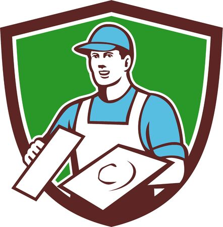 plasterer: Illustration of a plasterer masonry tradesman construction worker wearing hat holding trowel viewed from front set inside shield crest done in retro style on isolated background. Illustration