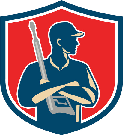 Illustration of power washer worker with arms crossed holding pressure washing gun looking to the side viewed from front set inside shield crest on isolated background done in retro style. Illustration