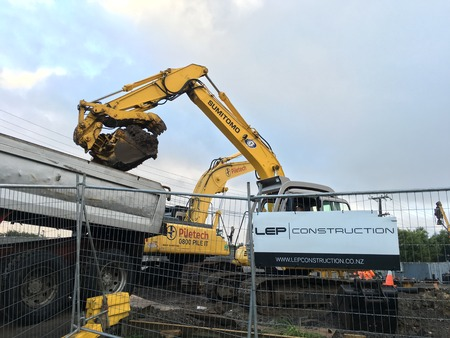 excavating machine: AUCKLAND, JUN. 14: Mechanical digger excavator in operation at project construction work site in Auckland, New Zealand taken on June 14, 2016.