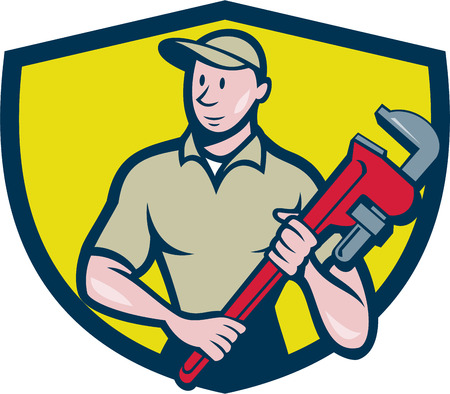 monkey wrench: Illustration of a plumber in overalls and hat standing looking to the side holding monkey wrench viewed from front set inside shield crest on isolated background done in cartoon style.