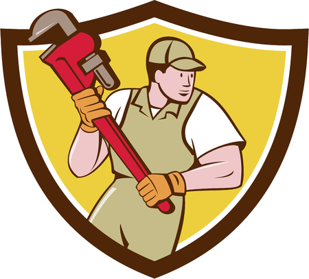 Illustration of a plumber holding giant pipe wrench looking to the side viewed from front set inside shield crest on isolated background done in cartoon style. Illustration